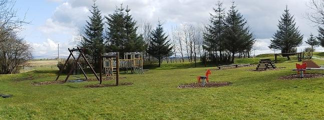 The childrens play area is located away from the cottages