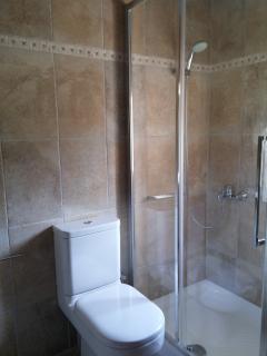 Upstairs bathroom with a bathtub