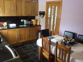Fully fitted kitchen seats six