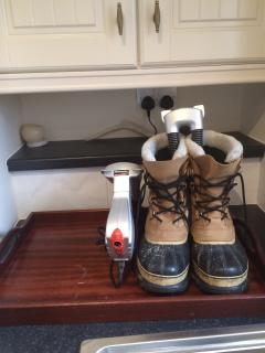 2 boot dryers in utility room with timer