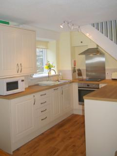 Kitchen overlooks outdoor pool. Has washing machine and dishwasher