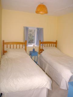 2nd bedroom with 2 full size single beds