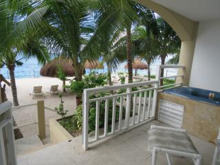 Steps to the beach from the private terrace with Jacuzzi