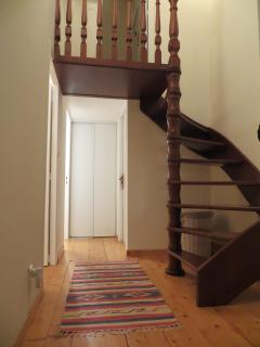 Featured staircase leading to 3rd bedroom