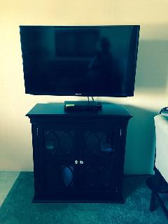 40' smart TV and blue ray player. located in the front room