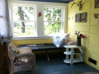 The sunroom (the former store) with cot
