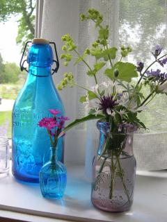 Old glass and flowers from the garden