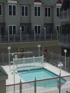 view of the pool from the deck off the kitchen (deck also has a large gas grill)