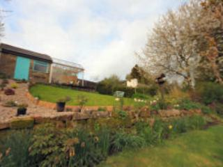 The garden with lots of seasonal produce and a wonderful summer house to relax in