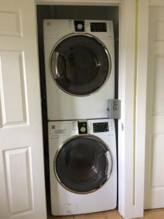 Stackable washer and dryer.just outside the suite. $2/wash and $2/dry