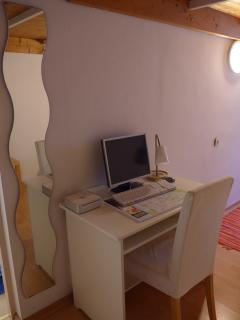 Writing desk with Apple computer.