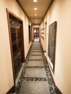 The loose-stone hallway provides access to the bedrooms.