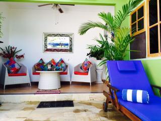 Outdoor room overlooking tropical pool
