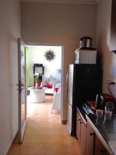 Fully equipt galley kitchen,fridge freezer, MW,cooktop,everything you need. Glass door to pool.
