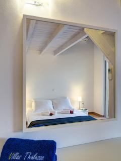 Mirror reflection of the restful bedroom 2