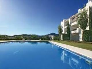 Modern open plan 2 bed on a golf resort, Marbella