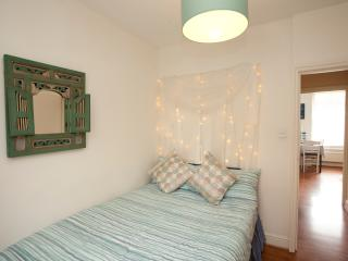 Bedroom with fairy light feature and Indian mirror