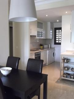 Open plan kitchen diner which differs from any other apartment on Roda.
