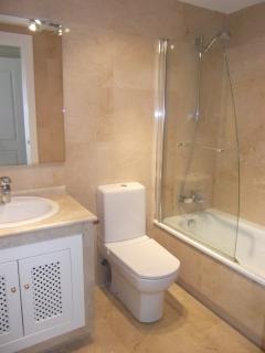 Double bedroom en suite with bath and shower.