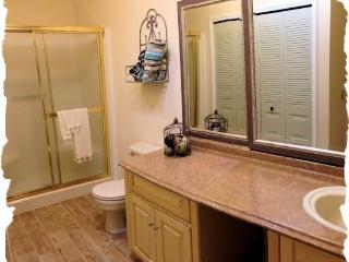 Master Bath with washer and dryer.