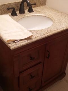 New vanity, granite top and faucet, master bath