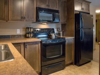 Kitchen with full appliances, supplies & stocked for making hearty homey meals.