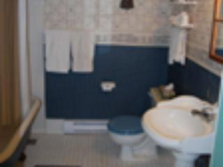 Full  bath, claw foot tub/shower/pedestal sink, towels, soap, shampoo, hair dryer