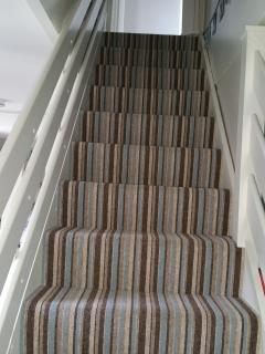 Staircase with retractable stair gates, top and bottom
