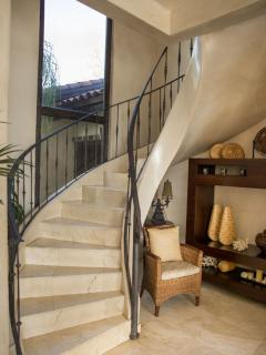 Beautifully-designed, winding staircase to the second floor
