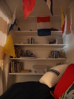 Alcove shelves hold books for all ages.