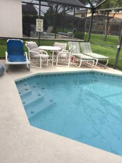 private pool area with screened lanai and optional pool heat.