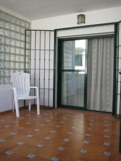 Patio doors from Bedroom 1 open out onto the terrace