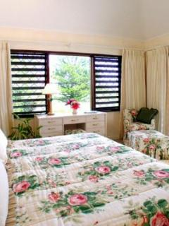 One of four Master Bedrooms, green bedroom.