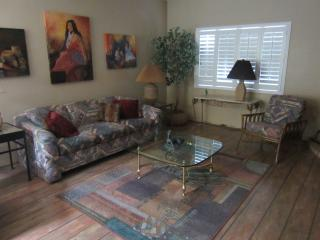 Living Room with S.W. artwork. New plantation shutters on four windows.