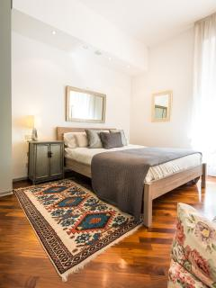 Villa Elika master bedroom with private balcony and Duomo views.