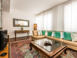 Masterfully crafted warm designer living room to welcome family or friends Exquisitely tasteful.