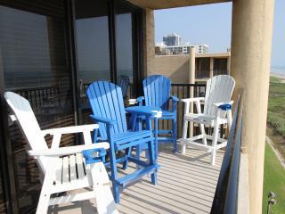 Balcony seating, top floor, corner unit. Great beach view.