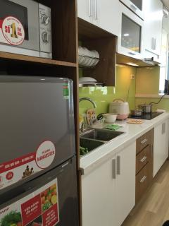 Microwave and fridge at kitchen