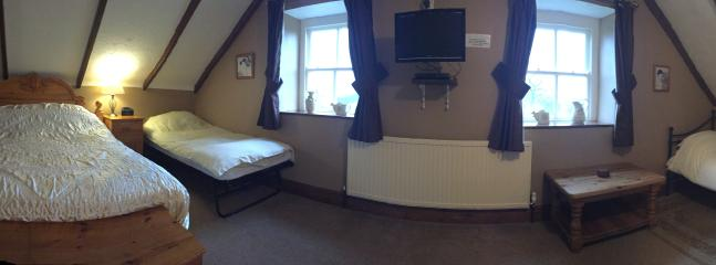 Panorama of Family room to show all beds set up