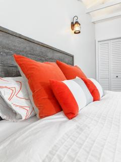 'Barn Room': handmade unique reclaimed wood headboard, plush and luxurious pillows and beddings.