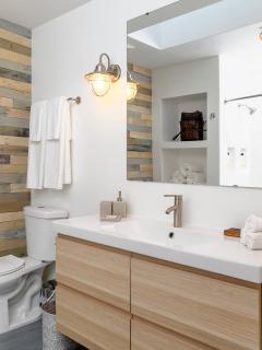 'Blue Room' bathroom: retro barnlights, custom tile work, cool niches, light and airy.
