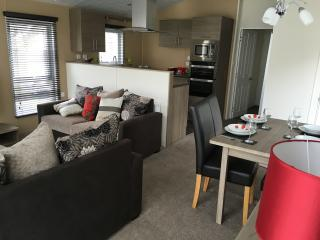 Modern fitted kitchen and comfortable seating area with TV, Wifi and sofa bed