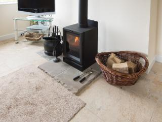 Comforting warmth from the stove. Beautiful ceramic tile flooring