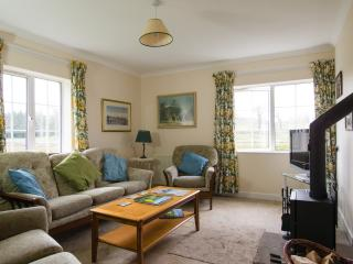 Living Room. Warm and comfy place to relax with wood fired multifuel stove. Fabulous views of Tweed