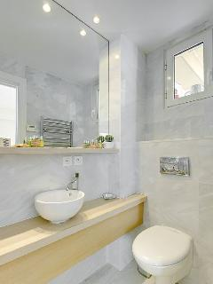 Ensuite bathroom to second bedroom with L'Occitane goodies and heated towel rail.