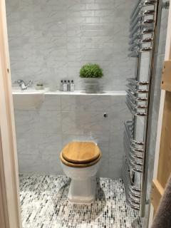 Elegant wet room, underfloor heating,  and electric towel rail. Toiletries and Towels provided.