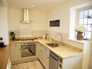 Kitchen with granite and oak worktops.