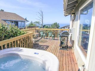Hot Tub, Movie Library, Four bedrooms, and Bar for a great getaway!