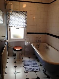 Upstairs bathroom with Victorian roll top bath, loo and sink