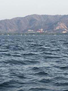 Scenic view of Playas del Coco Bay, house is located in the red circle
